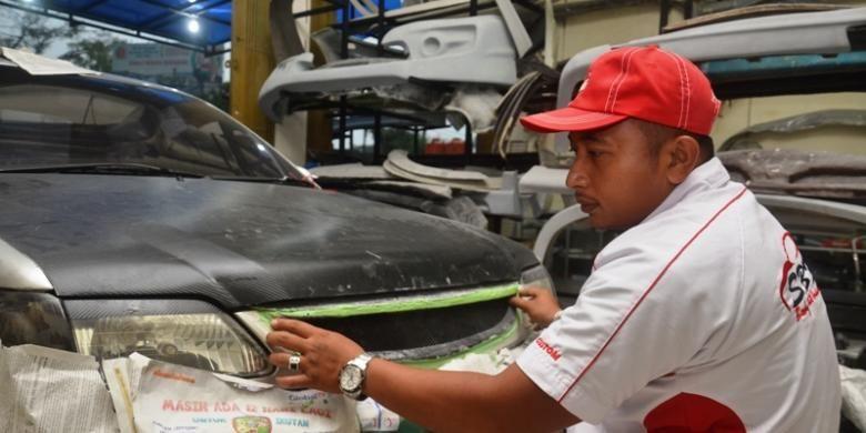 Ilustrasi Pemasangan Body Mobil